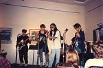 Jay T. Yamamoto playing live with band.
