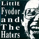 """In a most unlikely pairing, Little Fyodor teams up with GX Jupitter-Larsen of The Haters for an extremely short 7"""" record of bizarre noise and lo fi, cackling, howling vocals .This came out in 1998 on the Noiseopoly label. It is less than 10 seconds on each side."""